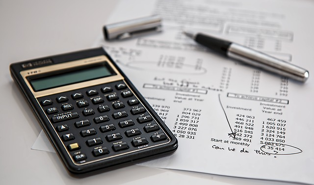 A calculator and some sums on a piece of paper