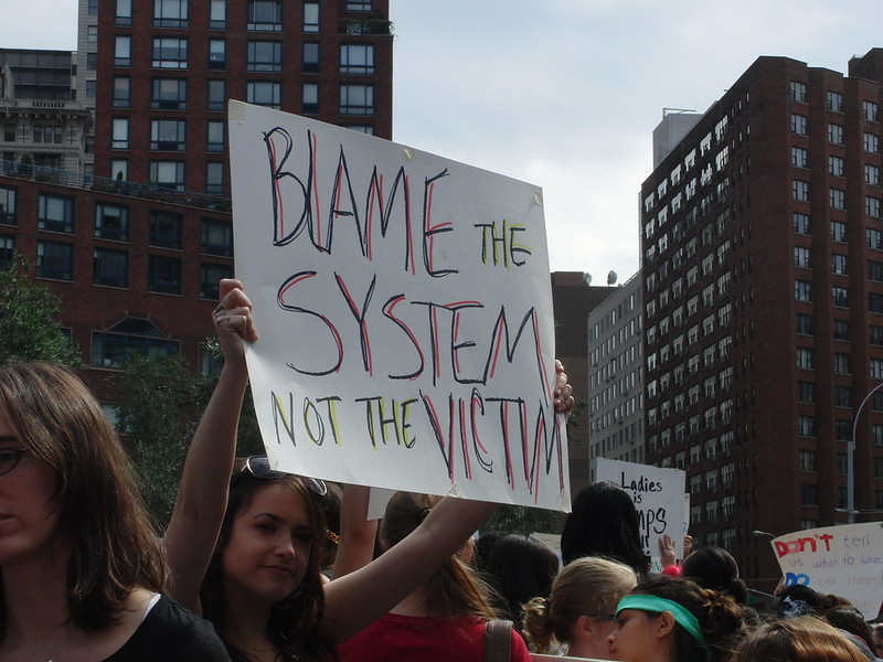 Blame the System Not the Victim